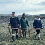 MIKAN 4324293 Two men, one in middle is Kananginak Pootoogook, and a woman return from fishing, Cape Dorset, Nunavut   [between June-September 1960]. [231 KB, 1000 X 999]
