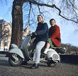 MIKAN 4324380 Bob Middleton and Jan Wilson on a scooter.  Neuchâtel Junior College in Switzerland  [1956]. [243 KB, 1000 X 967]