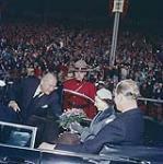 MIKAN 4314050 Queen Elizabeth and H.R.H. Prince Philip about to depart from Lansdowne Park, receiving flowers in car. Oct. 16, 1957.Ottawa, Ont.   [La reine Élizabeth et le prince Philip reçoivent des fleurs lors de leur départ en voiture du Parc Landsdowne, le 16 octobre 1957. Ottawa, Ontario] 16 octobre 1957. [177 KB, 1000 X 1005]