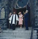 MIKAN 4314083 H.R.H. Princess Margaret accompanied by the Dean of Ottawa, the very Rev. J.O. Anderson, leaving Christ Church Cathedral. Ottawa, Ont.  [La princesse Margaret, accompagnée du doyen de l'université d'Ottawa, le révérent J.O. Anderson, descendant les escaliers de la cathédrale Christ Church. Ottawa, Ontario] [Entre juillet et août 1958]. [H.R.H. Princess Margaret accompanied by the Dean of Ottawa, the very Rev. J.O. Anderson, leaving Christ Church Cathedral. Ottawa, Ont., [Entre juillet et août 1958].]