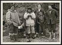 "MIKAN 4310996 Rosemary Gilliat Eaton, Barbara Hinds, Sarpinak, Spyglassie, Mosesee and Pitsulak on ""Spyglassie island,"" near Iqaluit (formerly Frobisher Bay), Nunavut  [between 18-19 August, 1960]. [Rosemary Gilliat Eaton, Barbara Hinds, Sarpinak, Spyglassie, Mosesee and Pitsulak on 'Spyglassie island,' near Iqaluit (formerly Frobisher Bay), Nunavut, [between 18-19 August, 1960].]"