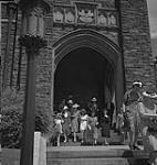 MIKAN 4315597 Toronto, church goers exiting Timothy Eaton Memorial Church on St. Clair Avenue West. [between 1939-1951]. [191 KB, 1000 X 1053]