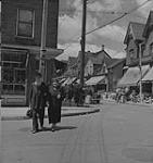 MIKAN 4315634 Toronto, street view of Kensington market. [between 1939-1951]. [160 KB, 1000 X 1058]