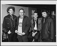 MIKAN 4363200 Portrait of (Left to Right) Chuck Mead (BR5-49), Moe Berg (The Pursuit of Happiness), Smilin' Jay McDowell (BR5-49), Paul Meyers (Musician / journalist) [between 1990-1996]. [125 KB, 1000 X 804]