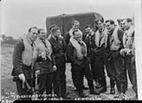 MIKAN 4327127 Squadron Leader McNab with nine of his Battle of Britian Pilots. September 12, 1940 [Squadron Leader McNab with nine of his Battle of Britian Pilots., September 12, 1940]