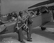 MIKAN 4327219 Sergeant Pilot R.N. Bennet with student Leading Aircraftman C.J. Ladouceur  July 22, 1940 [Sergeant Pilot R.N. Bennet with student Leading Aircraftman C.J. Ladouceur, July 22, 1940]