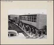 MIKAN 4365648 Students walking into a newly-built school in Windsor, Ontario. n.d. [Students walking into a newly-built school in Windsor, Ontario., n.d.]