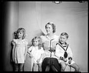 MIKAN 4333196 Mrs. Genest and 3 children. May 6, 1937 [Mrs. Genest and 3 children., May 6, 1937]