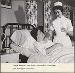 MIKAN 4370262 Aboriginal nurse Grace Manatch looking after a patient. [between 1930-1960] [194 KB]