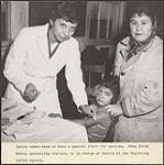MIKAN 4370274 Nurse Edith Green, in charge of health at the Nipissing Indian Agency, giving a shot to a young Aboriginal girl. [between 1930-1960] [Nurse Edith Green, in charge of health at the Nipissing Indian Agency, giving a shot to a young Aboriginal girl., [between 1930-1960]]
