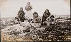 MIKAN 5275637 Inuit group from Schultz Lake resting while on route to hunt caribou at Thelon Game Sanctuary. 1930 [Inuit group from Schultz Lake resting while on route to hunt caribou at Thelon Game Sanctuary., 1930]