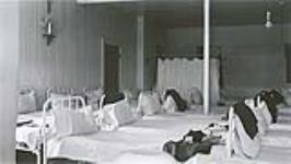MIKAN 4621167 [Dortoir des filles, Pensionnat indien d'Ermineskin, Hobbema (Alberta), 3 juin 1938]. 3 juin 1938 (Girls dormitory at Ermineskin Indian Residential School, Hobbema, Alberta, June 3, 1938) [[Dortoir des filles, Pensionnat indien d'Ermineskin, Hobbema (Alberta), 3 juin 1938]., 3 juin 1938]