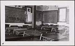 MIKAN 4621168 [Vue sud-ouest de la classe de première année au rez-de-chaussée, Pensionnat indien d'Ermineskin, Hobbema (Alberta), 3 juin 1938]. 3 juin 1938 (Grade 1 classroom on main floor, looking southwest, Ermineskin Indian Residential School, Hobbema, Alberta, June 3, 1938) [[Vue sud-ouest de la classe de première année au rez-de-chaussée, Pensionnat indien d'Ermineskin, Hobbema (Alberta), 3 juin 1938]., 3 juin 1938]