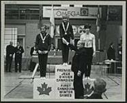 MIKAN 4741173 Prime Minister Lester B. Pearson congratulating medal winners of gymnastics at the first Canadian Winter Games at Québec City  February 11-19, 1967. [Prime Minister Lester B. Pearson congratulating medal winners of gymnastics at the first Canadian Winter Games at Québec City, February 11-19, 1967.]