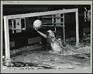 MIKAN 4741197 Ontario water polo goalie Dave McClintock made several saves like this as Ontario went on to swamp Nova Scotia 24-1 during the Second Canada Summer Games at New Westminster-Burnaby. August 1973. [204 KB, 1000 X 802]