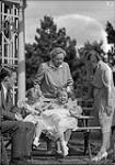 MIKAN 4759527 H.R.H. Princess Juliana with Queen Wilhelmina, Prince Bernhard, and 3 Princesses at house, July 1, 1943  1943. [H.R.H. Princess Juliana with Queen Wilhelmina, Prince Bernhard, and 3 Princesses at house, July 1, 1943, 1943.]