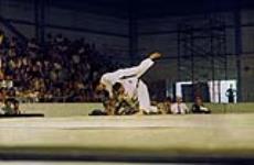 MIKAN 4814191 Judokas in action at the 1967 Pan Am Games in Winnipeg  1967. (Judokas en action lors des Jeux panaméricains du 1967 à Winnipeg) [Judokas in action at the 1967 Pan Am Games in Winnipeg, 1967.]