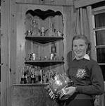 MIKAN 3401294 Mrs. Louise Wheeler of St.-Jovite P.Q. with her skiing Trophies. The 1958 World Ski Champion and Canada's Outstanding Women's Amateur Athletic. 1958. [Mrs. Louise Wheeler of St.-Jovite P.Q. with her skiing Trophies. The 1958 World Ski Champion and Canada's Outstanding Women's Amateur Athletic., 1958.]