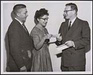 MIKAN 5313660 [Miss Mavis Brass receiving a university scholarship offered by the Indian Affairs Branch for the Saskatchewan Region. Miss Brass is enrolled in a degree course for nursing at the University of Saskatchewan]. [ca. 1960] [[Miss Mavis Brass receiving a university scholarship offered by the Indian Affairs Branch for the Saskatchewan Region. Miss Brass is enrolled in a degree course for nursing at the University of Saskatchewan]., [ca. 1960]]