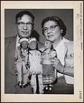 MIKAN 5313672 [Mr. and Mrs. Alex H. Brass of Peepeekisis Cree Nation with their First Nations marionettes at the fifth annual Indian and Métis Conference in Winnipeg]. Original title: Puppetry. Mr. and Mrs. Alex H. Brass of Peepeekisis Reserve with their Indian marionettes. Fifth Annual conference on Indian and Métis problems in Winnipeg. 26 February 1959 [[Mr. and Mrs. Alex H. Brass of Peepeekisis Cree Nation with their First Nations marionettes at the fifth annual Indian and Métis Conference in Winnipeg]. Original title: Puppetry. Mr. and Mrs. Alex H. Brass of Peepeekisis Reserve with their Indian marionettes. Fifth Annual conference on Indian and Métis problems in Winnipeg., 26 February 1959]