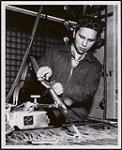 MIKAN 5320425 Ivan Peter Meawasige of the Serpent River Band, Sault Ste. Marie Agency, is taking a Welding Course at the Provincial Institute of Trades in Toronto as a student under the Indian Affairs Placement Program. [between 1900-1976] [Ivan Peter Meawasige of the Serpent River Band, Sault Ste. Marie Agency, is taking a Welding Course at the Provincial Institute of Trades in Toronto as a student under the Indian Affairs Placement Program., [between 1900-1976]]