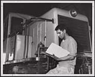 MIKAN 5320427 Bernie Jacobs of the Serpent River Band is employed by Noranda Mines Limited as a clerk in its sulphuric acid plant. [ca. 1959] [Bernie Jacobs of the Serpent River Band is employed by Noranda Mines Limited as a clerk in its sulphuric acid plant., [ca. 1959]]