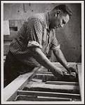 MIKAN 5320410 Wesley Johnson has been working at the Hepworth Furniture Company plant in Southampton, Ontario, since 1957. [ca. 1959] [Wesley Johnson has been working at the Hepworth Furniture Company plant in Southampton, Ontario, since 1957., [ca. 1959]]