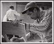 MIKAN 5320411 Wilfred Cameron has been working in the cabinet shop of the Hepworth Furniture Co., Southampton, Ontario, since 1958. [ca. 1959] [Wilfred Cameron has been working in the cabinet shop of the Hepworth Furniture Co., Southampton, Ontario, since 1958., [ca. 1959]]