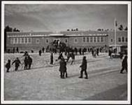 MIKAN 5320397 [Children playing outside during recess at Rabbit Lake Public School]. February 1961 [[Children playing outside during recess at Rabbit Lake Public School]., February 1961]