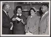 MIKAN 5320347 [Miss Sally Joy Kennedy, 18, Lenape of the Caradoc Indian Agency, receives her scholarship award cheque for $420.00 from Mr. J.E. Morris, Regional Supervisor of Indian Affairs for Southern Ontario, while her parents, Mr. and Mrs. Louis Kennedy, of Muncey, Ont., look on with pride]. Original title: Miss Sally Joy Kennedy, 18, an Indian of the Caradoc Indian Agency, receives her scholarship award cheque for $420.00 from Mr. J.E. Morris, Regional Supervisor of Indian Affairs for Southern Ontario, while her parents, Mr. and Mrs. Louis Kennedy, of Muncey, Ont., look on with pride. 23 December 1958 [[Miss Sally Joy Kennedy, 18, Lenape of the Caradoc Indian Agency, receives her scholarship award cheque for $420.00 from Mr. J.E. Morris, Regional Supervisor of Indian Affairs for Southern Ontario, while her parents, Mr. and Mrs. Louis Kennedy, of Muncey, Ont., look on with pride]. Original title: Miss Sally Joy Kennedy, 18, an Indian of the Caradoc Indian Agency, receives her scholarship award cheque for $420.00 from Mr. J.E. Morris, Regional Supervisor of Indian Affairs for Southern Ontario, while her parents, Mr. and Mrs. Louis Kennedy, of Muncey, Ont., look on with pride., 23 December 1958]