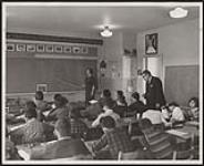 MIKAN 5320318 Another day of study begins at Tayendinaga [sic] Central School as Mr. and Mrs. Leslie Claus prepare some of their fellow Mohawks for the future. [ca. 1966] [Another day of study begins at Tayendinaga [sic] Central School as Mr. and Mrs. Leslie Claus prepare some of their fellow Mohawks for the future., [ca. 1966]]