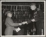 "MIKAN 5188854 An award for the ""Trooper who showed the most progress in a national survival course"" is handed to Pte. W.R. Kewageshig  [ca. 1962] [123 KB, 1000 X 803]"