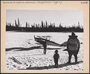 MIKAN 5159093 [Man and child watch another man approach a skiplane]. [between 1900-1976] (Mounted print) [192 KB, 1000 X 823]