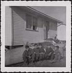 MIKAN 5188813 [Innu boys in front of their new house]. Original title: Chimo boys in front of their new house. September 1958 [[Innu boys in front of their new house]. Original title: Chimo boys in front of their new house., September 1958]
