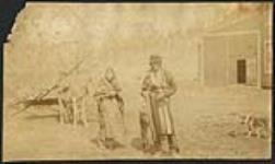 MIKAN 5112988 [First Nation man, woman, and child standing in front of horse and wagon]. [ca. 1885] [129 KB, 1000 X 596]