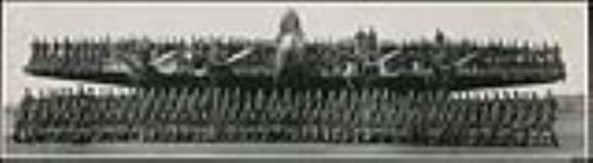 """MIKAN 5316001 Group photograph of W/C W.F.M. Newson and personnel of No. 431 (Iroquois) Squadron, R.C.A.F., with Handley Page """"Halifax"""" aircraft, Tholthorpe or Croft, Yorkshire, England  April 1944. [Group photograph of W/C W.F.M. Newson and personnel of No. 431 (Iroquois) Squadron, R.C.A.F., with Handley Page 'Halifax' aircraft, Tholthorpe or Croft, Yorkshire, England, April 1944.]"""