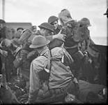MIKAN 4976317 [Wounded Canadian troops boarding a vessel after raid on Dieppe, France, 19 August 1942.]  August 19, 1942. [[Wounded Canadian troops boarding a vessel after raid on Dieppe, France, 19 August 1942.], August 19, 1942.]