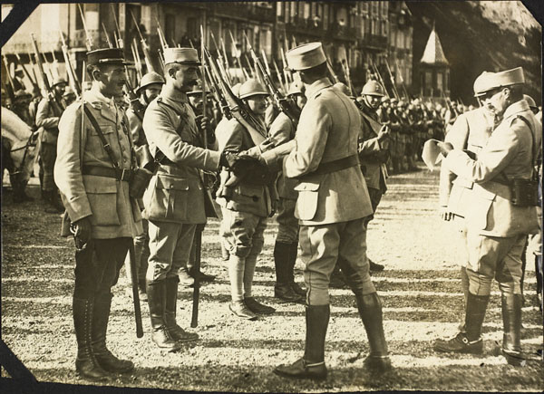 Photograph of  decorations being given to French soldiers, Le Tréport, France, ca. 1916-1917