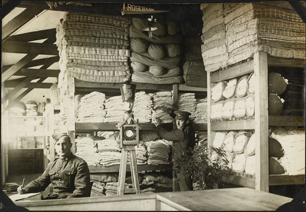 Photograph of two men in the linen storage room, No. 2 Canadian General Hospital, Le Tréport, France, 1917