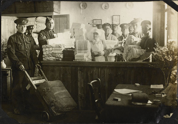 Photograph of a nursing sister and the staff of the Linen Stores, No. 2 Canadian General Hospital, Le Tréport, France, 1917