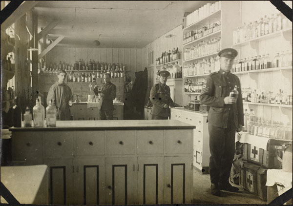 Photograph of four men in the pharmacy, No. 2 Canadian General Hospital, Le Tréport, France, 1917
