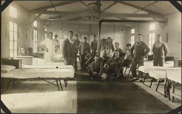 Photograph of a nursing sister and an orderly with a group of patients in a ward, No. 2 Canadian General Hospital, Le Tréport, France, 1917