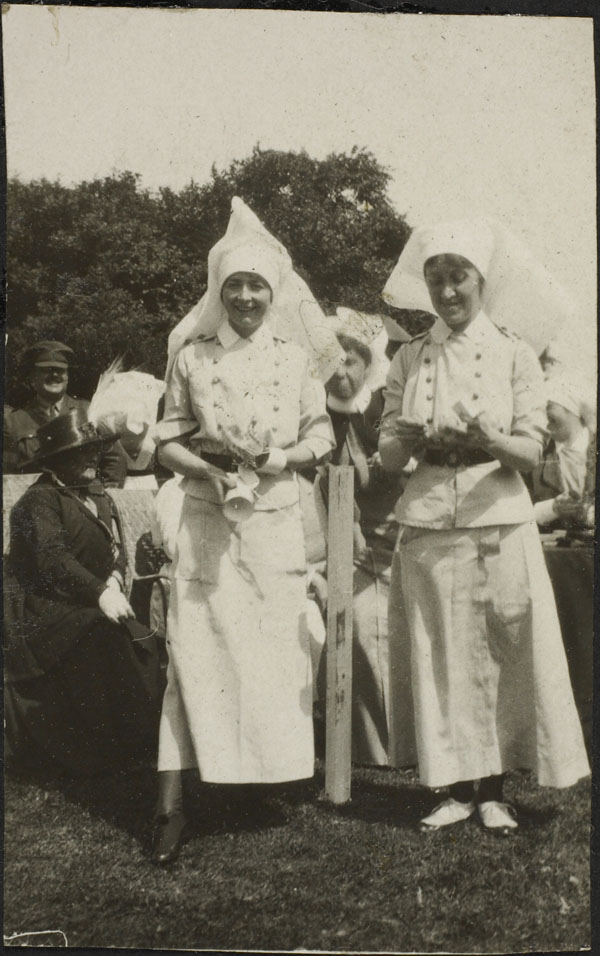 Photograph of nursing sisters Helen White and Elsie McCready competing in an egg and spoon race, Dominion Day Sports, No. 2 Canadian General Hospital, Le Tréport, France, July 2, 1917