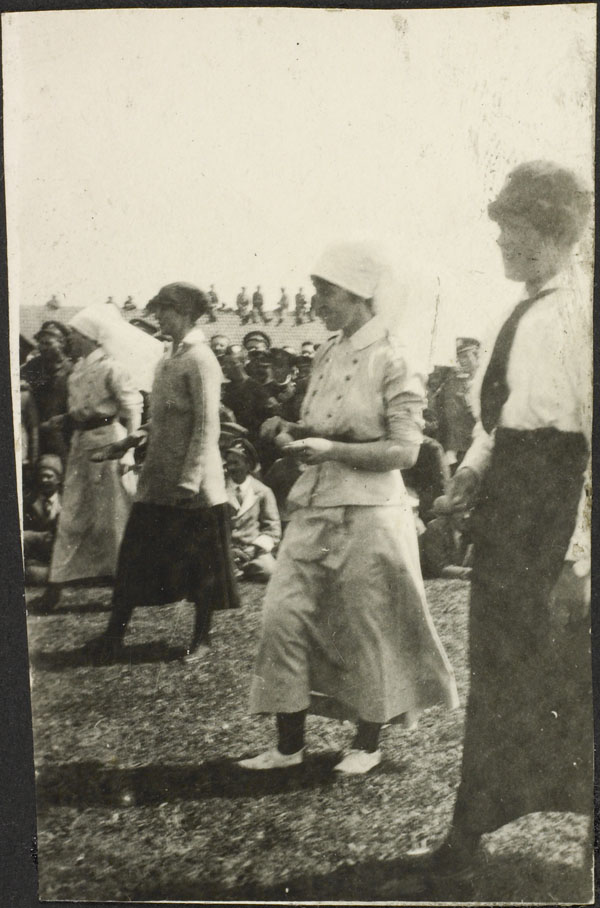 Photograph of four nursing sisters competing in an egg and spoon race, Dominion Day Sports, No. 2 Canadian General Hospital, Le Tréport, France, July 2, 1917