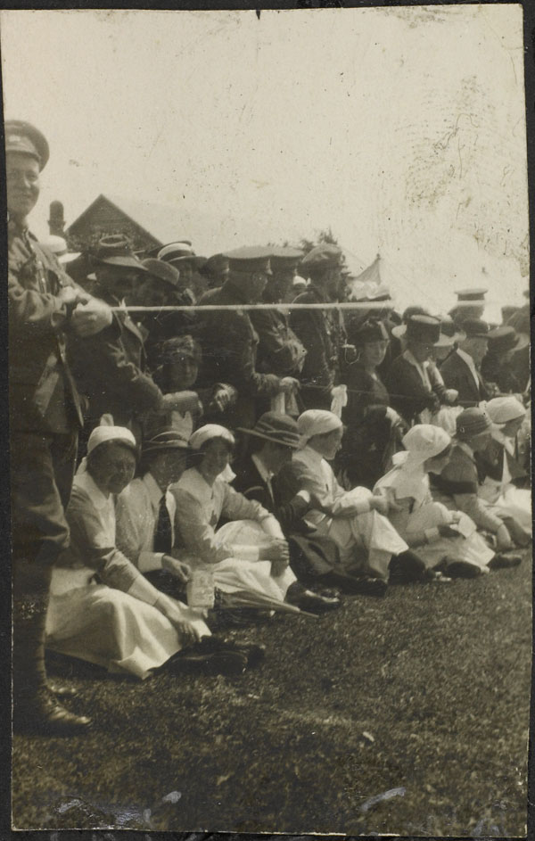 Photograph of a group of nursing sisters and officers, and the Mayor of Le Tréport watching the competitions, Dominion Day Sports, No. 2 Canadian General Hospital, Le Tréport, France, July 2, 1917